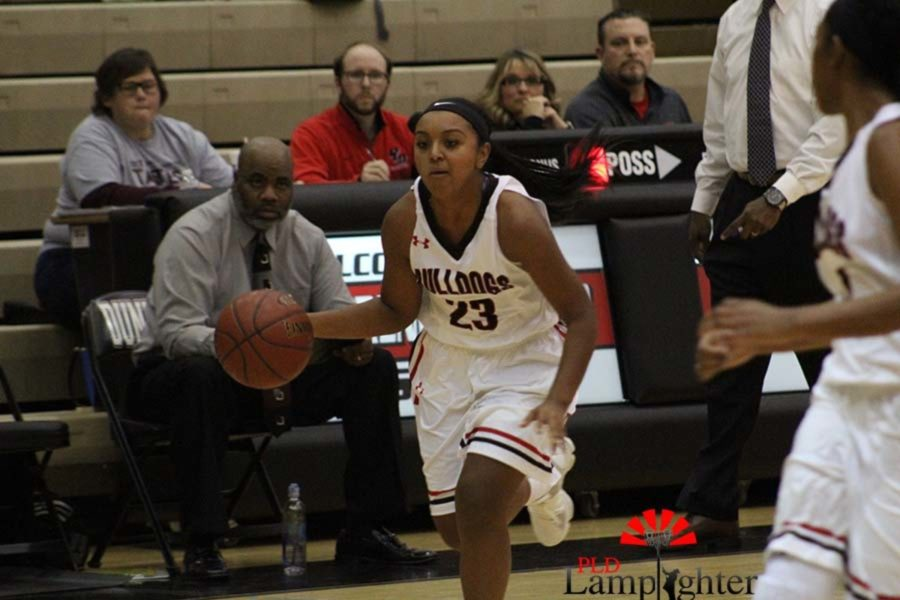 #23 Senior Mashayla Cecil drives the ball down the court.