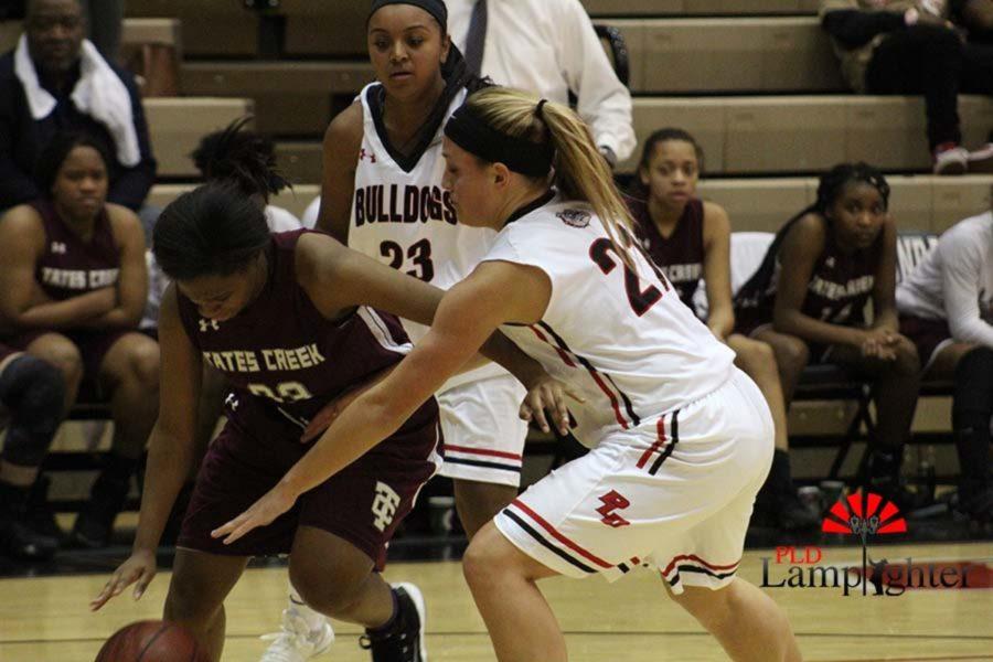 #21 Senior Peyton Humphreys playing defense on a Tates Creek player.