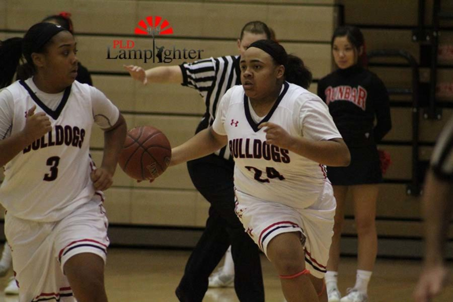 #24 Anaiyah Cotton looking for an open teammate.