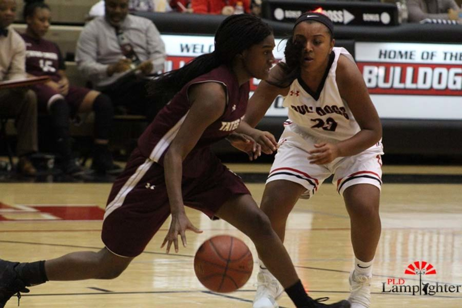 #23 Mashayla Cecil playing defensively against a Tates Creek player.