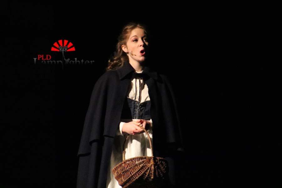 Belle (Katy Rucker) singing a solo.