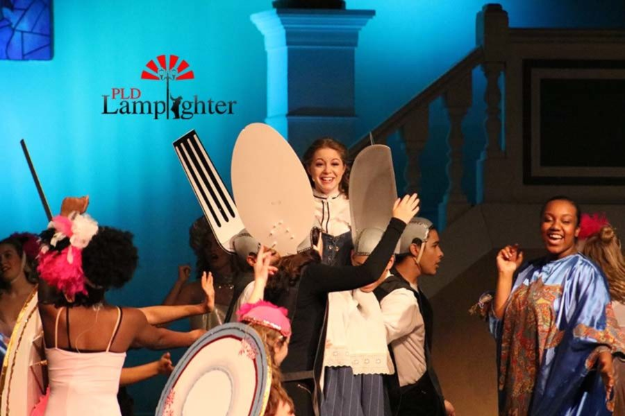 Belle (Katy Rucker) watches as the utensils sing