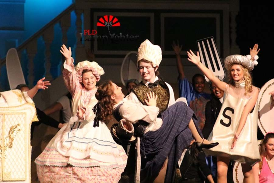 Lumiere (Daniel Clark) picks up Belle (Katy Rucker) at the finale of
