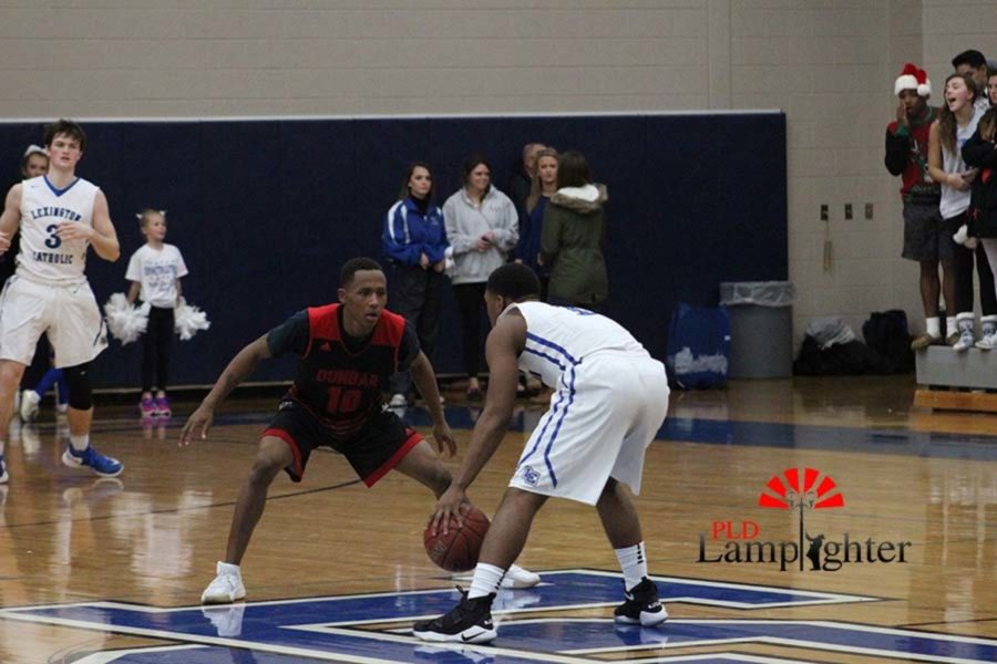 #10 JaQuice Gray guarding a Lexington Catholic player.