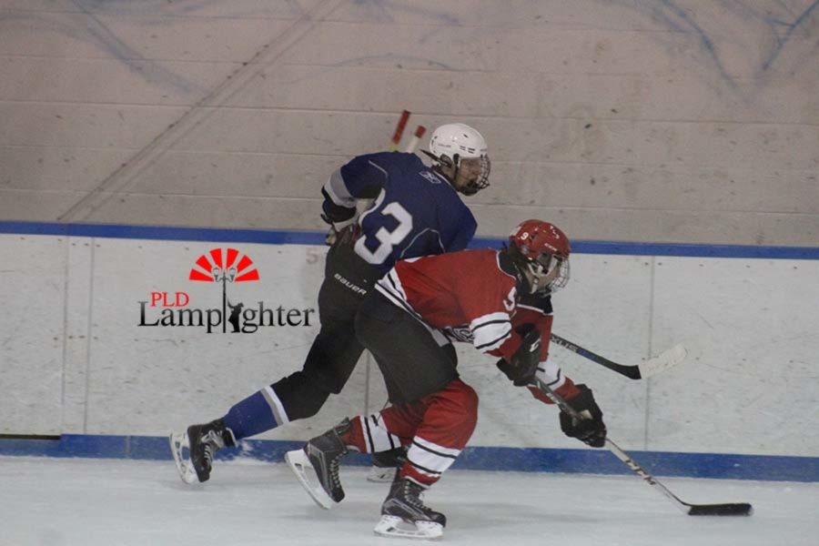 Aj Russell hitting a player off the puck.