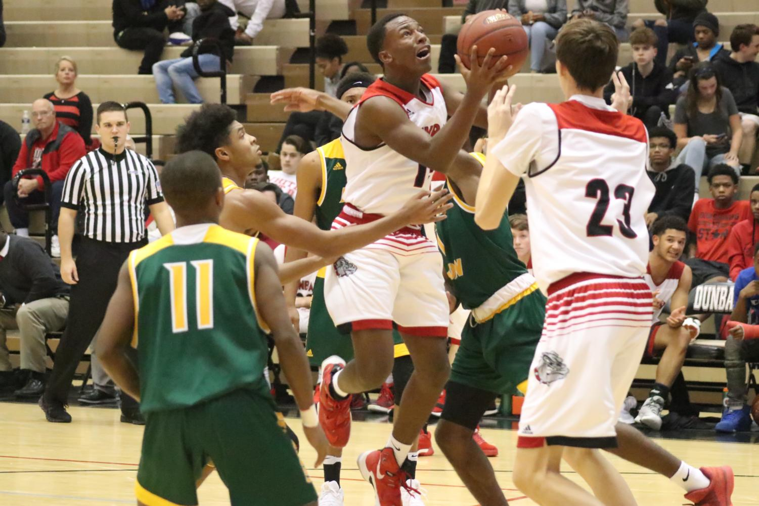 Boys' Basketball Faces Defeat At First Home Game