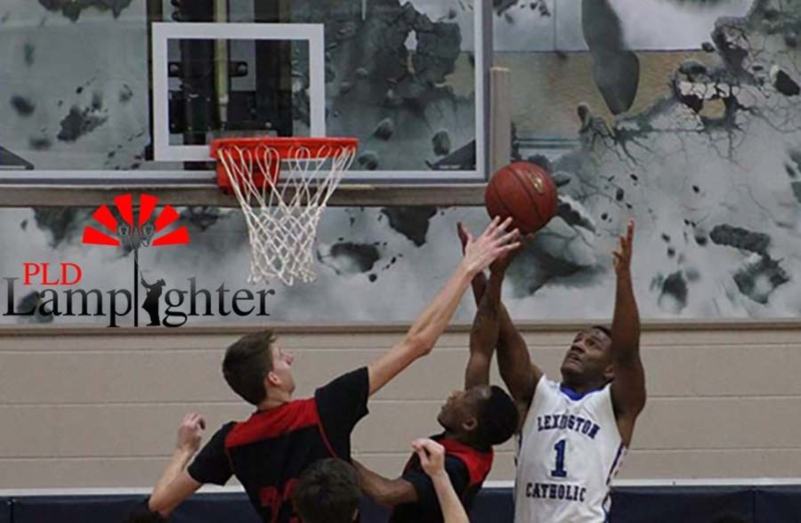 #23 Trevor Rogers #10 JaQuice Gray reach for the basketball.