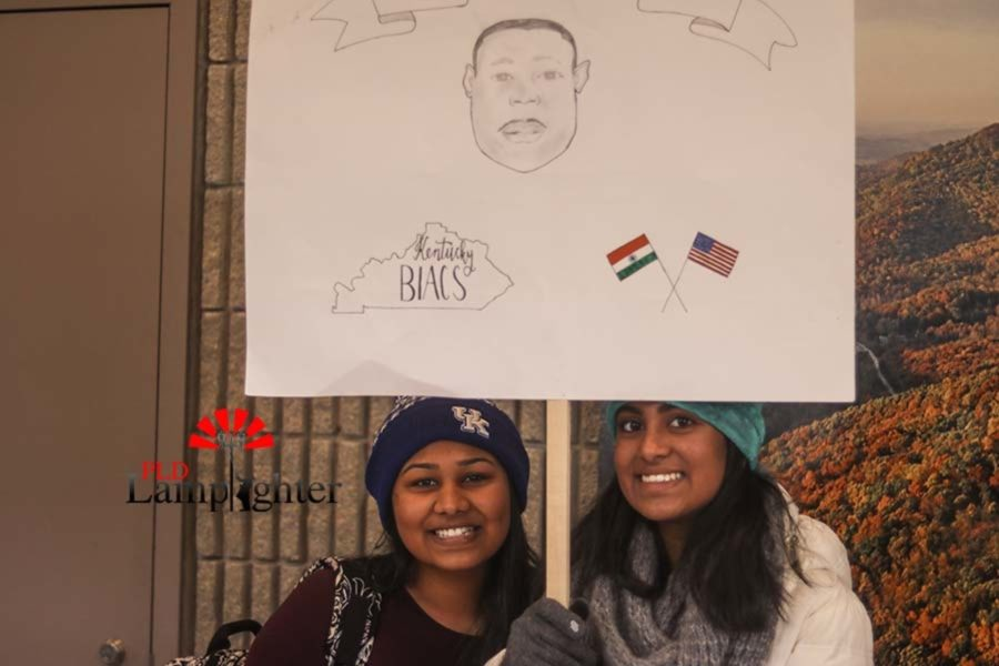 Dunbar sophomore Shreya Tamilesvan and freshman Rishita Sontenam raise a poster of MLK. The poster represented BIACS and the unity between the Indian and American community in Kentucky. The poster also included a drawing of MLK.