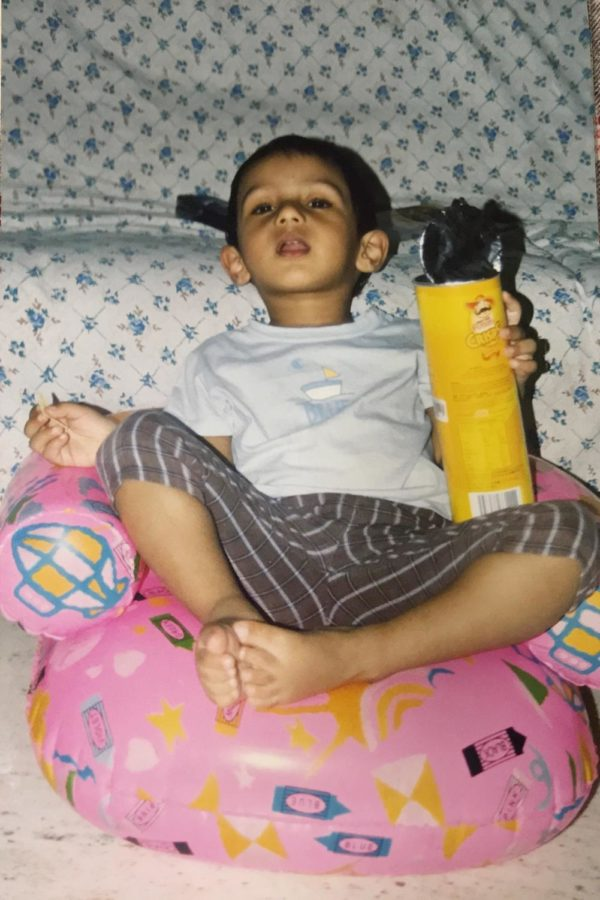 Growing up, my mom used Tollywood movies to bribe me to eat. Here I am, enjoying a film and some chips.