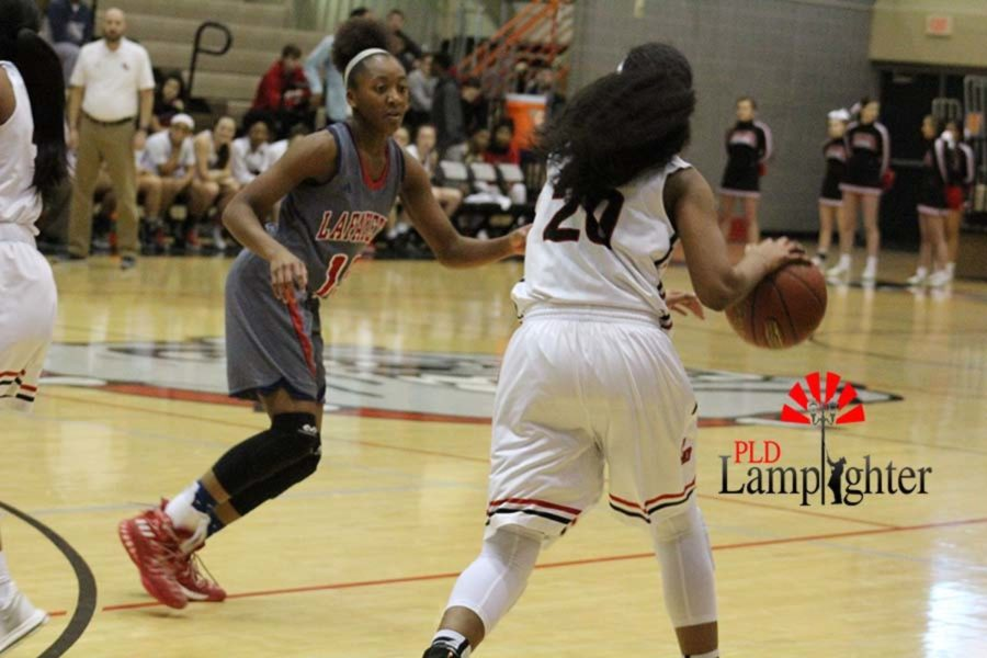 #20 Junior Cheyenne Fullwood dribbling while looking for an open teammate.