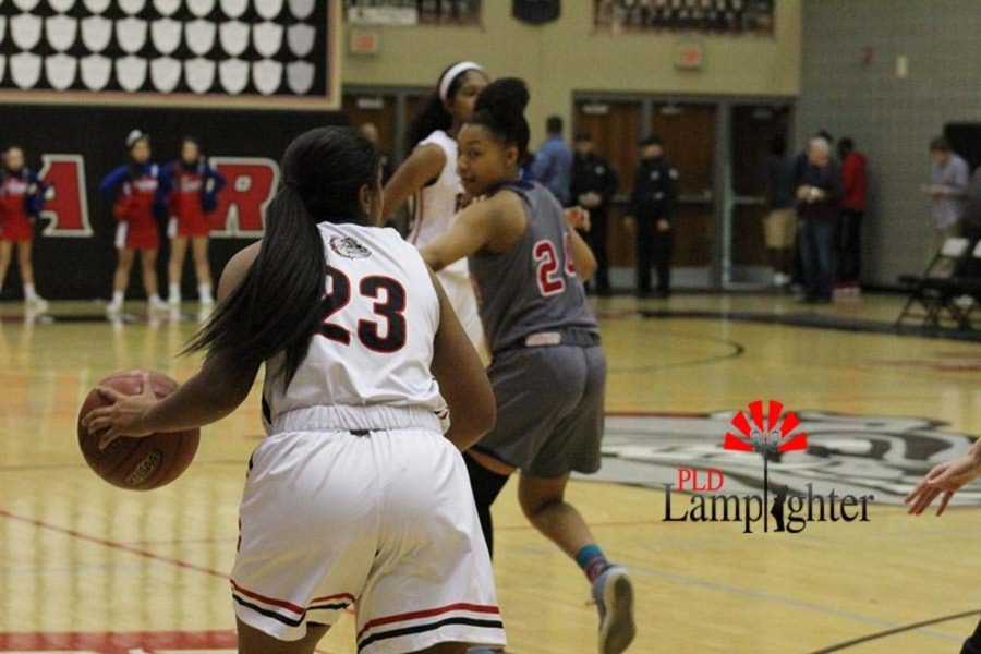 #23 Senior Mashayla Cecil dribbling down the court looking to make a play.
