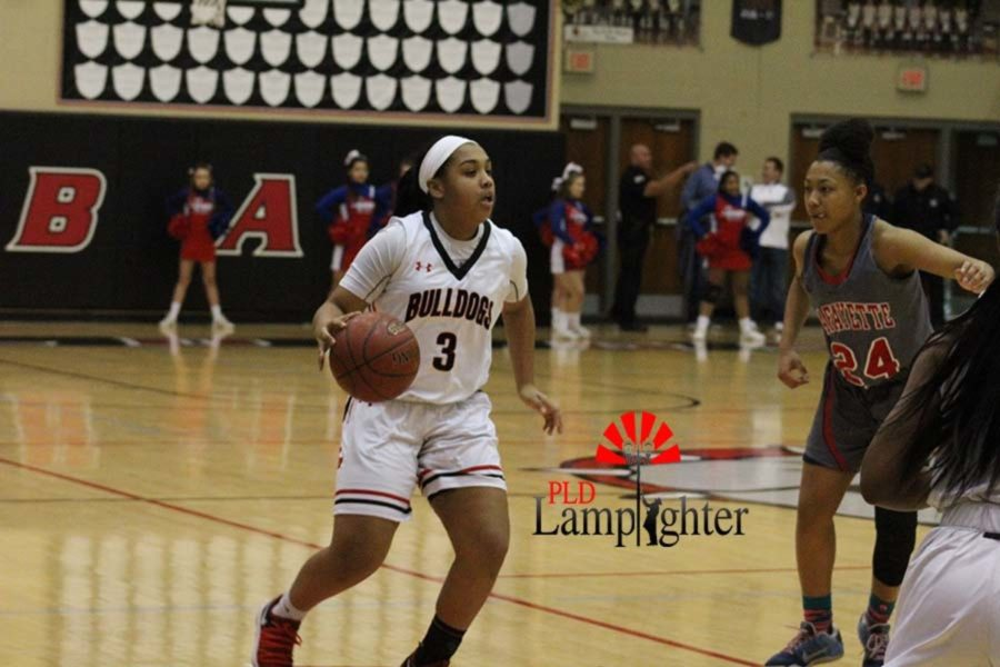 #3 Freshmen Tanaya Cecil looking for an open teammate to pass to.