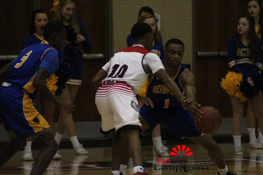 #10 Senior JaQuice Gray trying to get past a defender.
