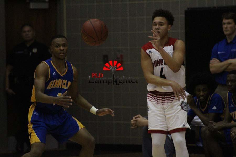 #4 Junior Isaiah Allen passing the ball to an open player.