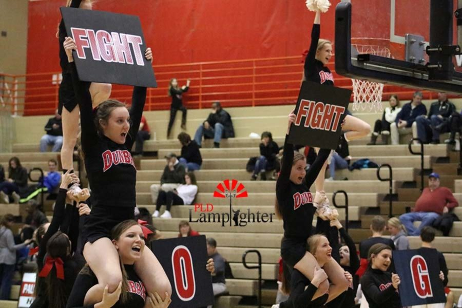 The cheerleaders encouraging the team to