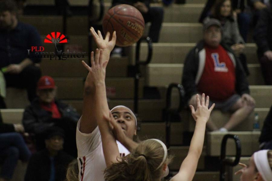 #24 Senior Anaiyah Cotton going up for a shot with tough defense on her.