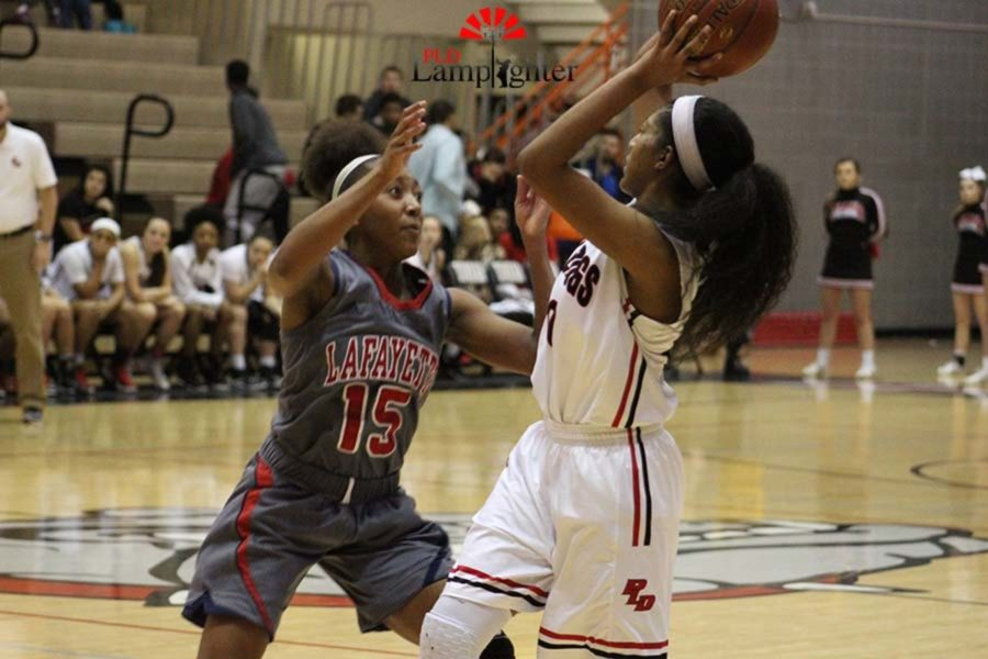 #20 Junior Cheyenne Fullwood looking to pass to an open teammate.