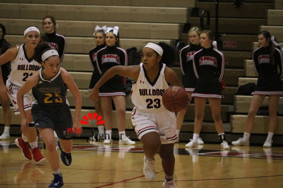 #23 Mashayla Cecil looks for an open teammate.