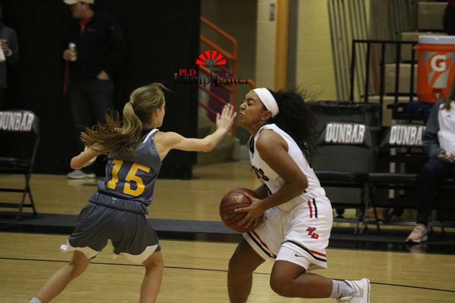 #23 Mashayla Cecil doges an opposing player.