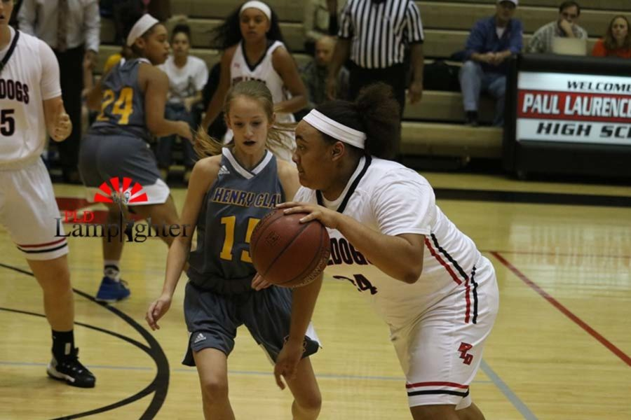 #24 Anaiyah Cotton attempts to pass a Henry Clay player.