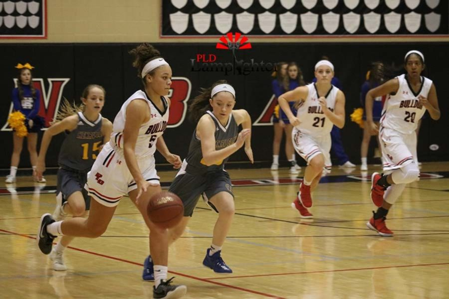 #5 Freshman Elise Ellison-Coons dribbles the ball down the court.