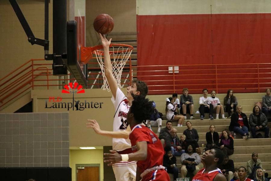 #23 Junior Trevor Rogers gets above the defense to shoot the uncontested layup.