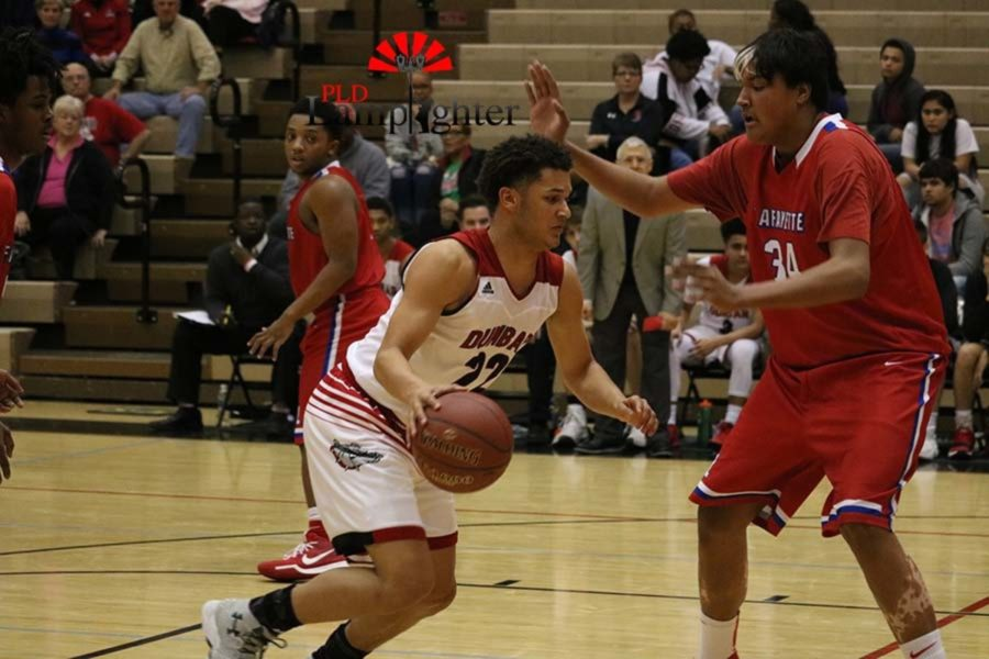 #22 Junior Michael Corio drives past the defender to get to the basket.