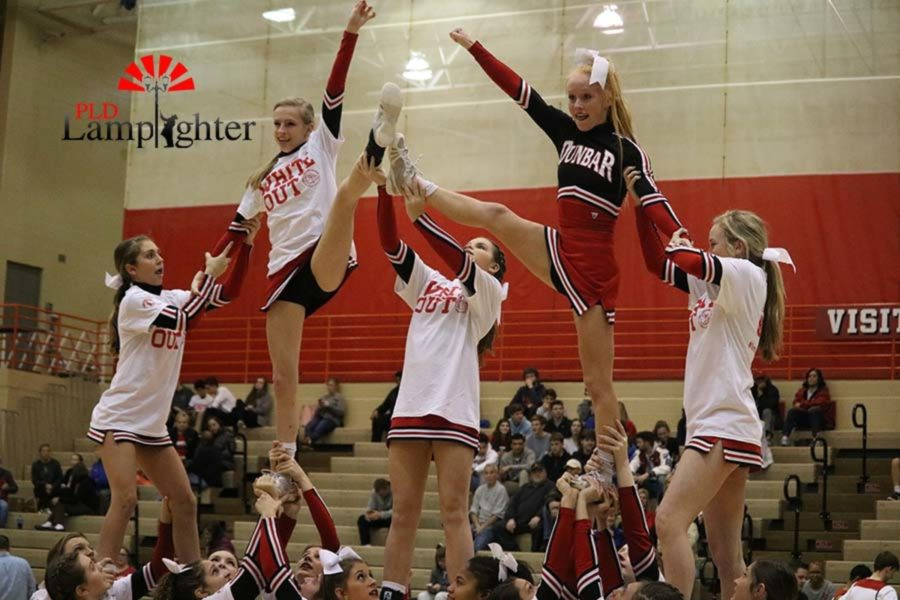 The cheerleaders performing their routine.