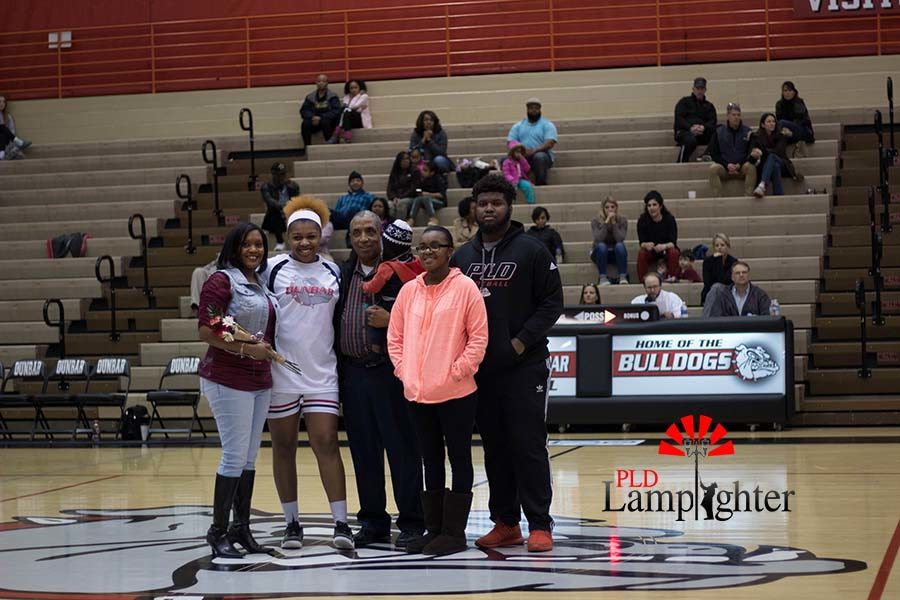 Senior Janae Stevenson and family.