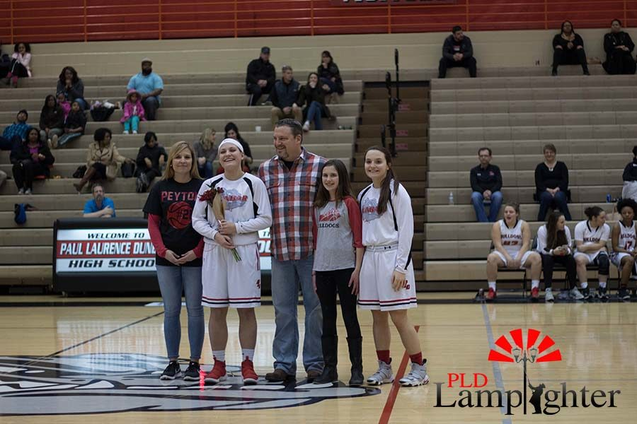 Senior Peyton Humphreys and family posing for a photo.