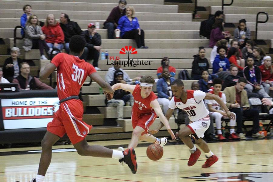 #10 Senior JaQuice Gray getting the ball stolen.