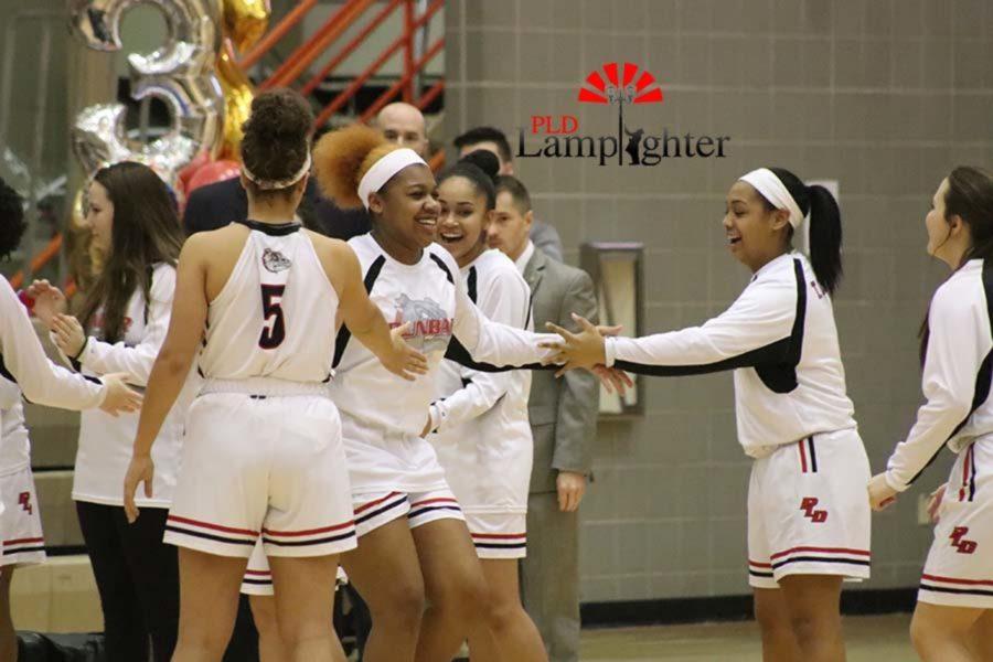 Janae+Stevenson+high-fiving+teammates.+