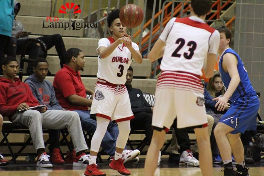 #3 Sophomore Robby Kinnard passing the ball to #23 junior  Trevor Rogers.