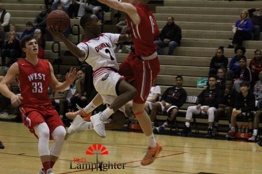 #2 Senior JaQuon Gray going up with a shot.