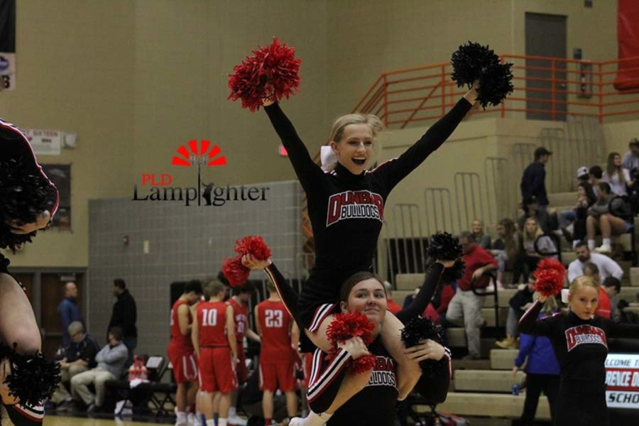 Sophomore Marissa Rajcan cheering on the bulldogs.