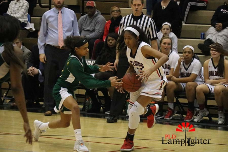 #20 Junior Cheyenne Fullwood Driving Past a defender.