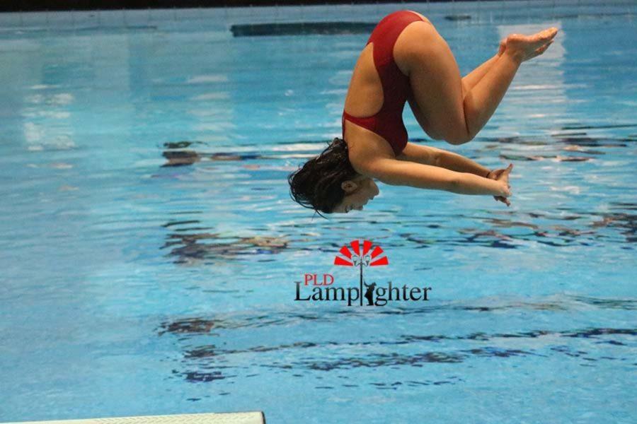 Senior Julia Radhakrishnan spots the water to know when to release her inward dive tuck.