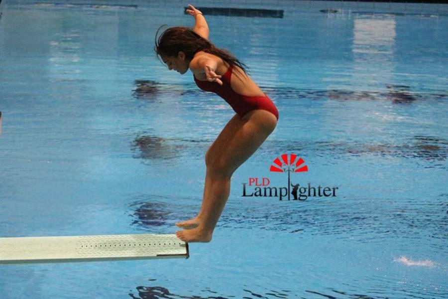 Senior Julia Radhakrishnan does a backwards take-off in preparation for her skill.