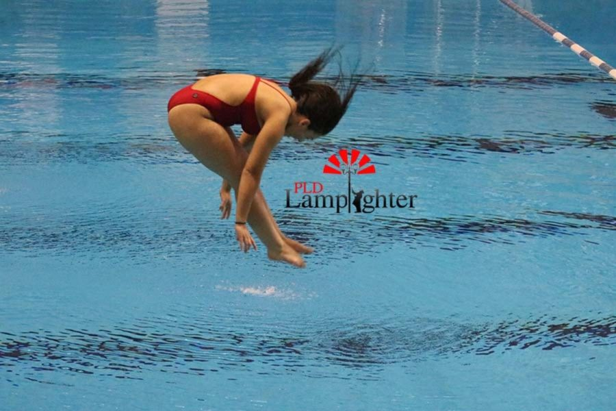 Senior Julia Radhakrishnan in the final stages of her front one-and-a-half somersault pike.