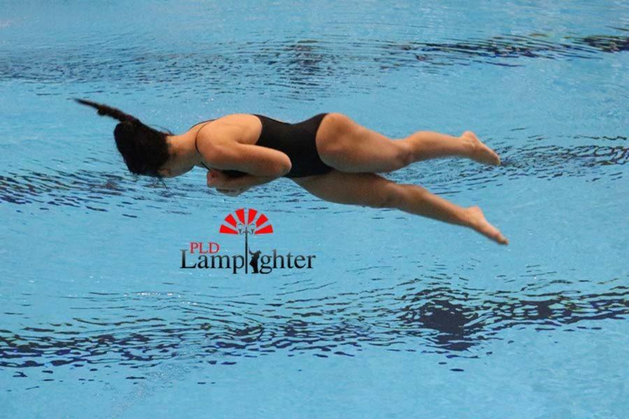 Freshman Alexis Radhakrishnan competes a twister dive.