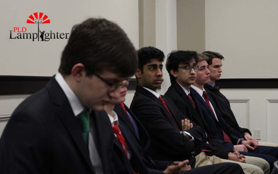 Students listen as they sit in on a meeting that discusses pensions.