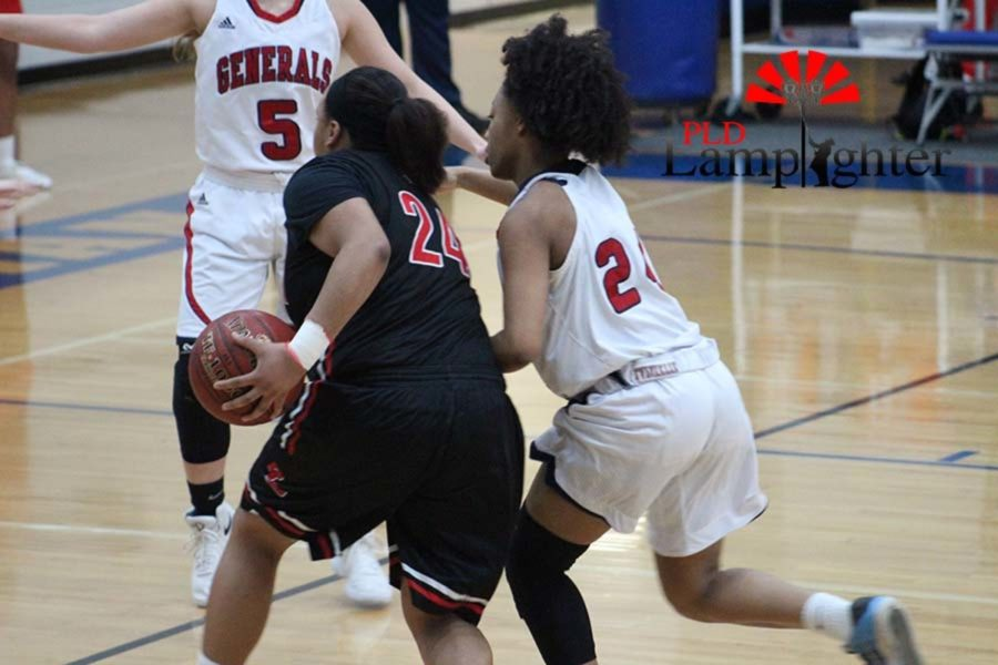 #24 Senior Anaiyah Cotton driving to the basket