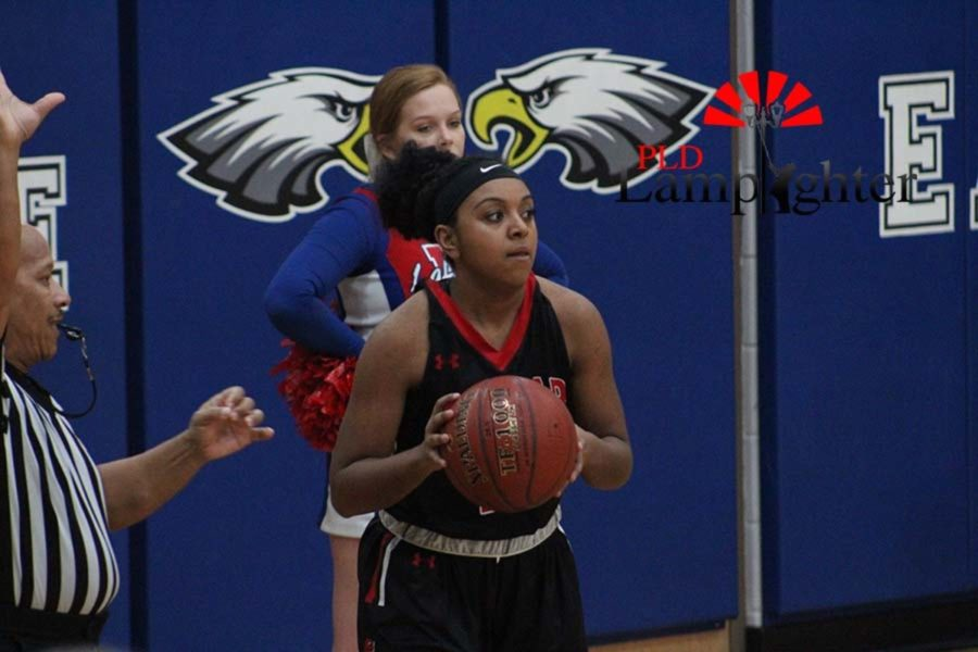 #23 Senior Mashayla Cecil looks to inbound the ball.