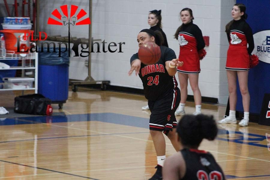 #24 Senior Anaiyah Cotton passes the ball to an open teammate.