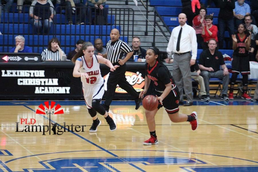 #3 Freshman Tanaya Cecil dribbles up court getting past the defender.