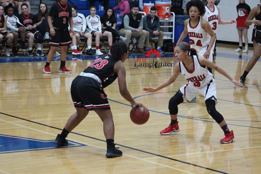 #23 Senior Mashayla Cecil dribbles the ball looking to make a play.