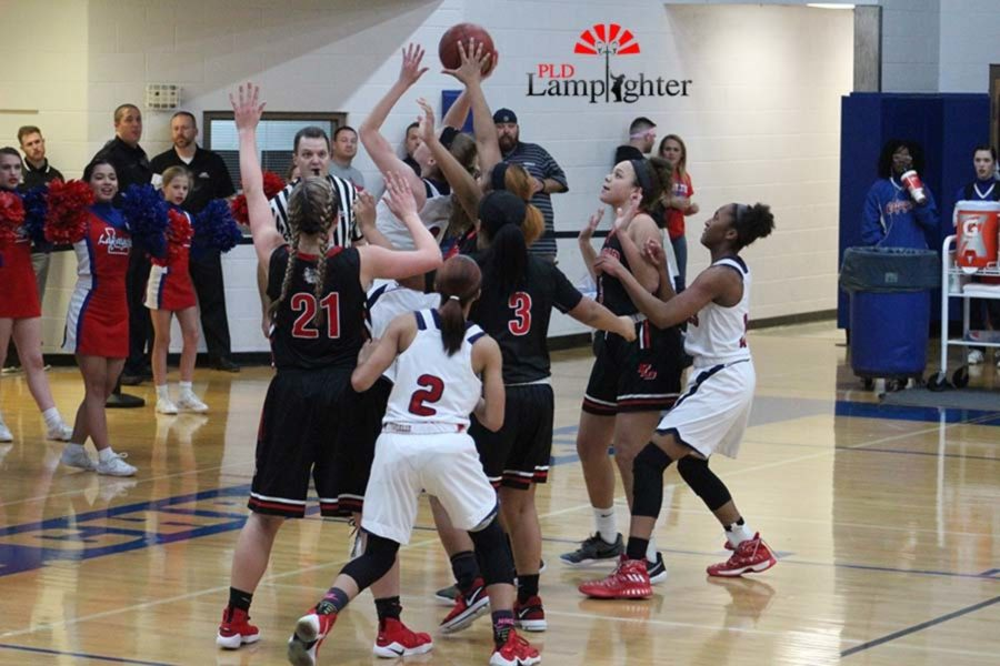 #42 Senior Janae Stevenson blocks the opposing players shot.