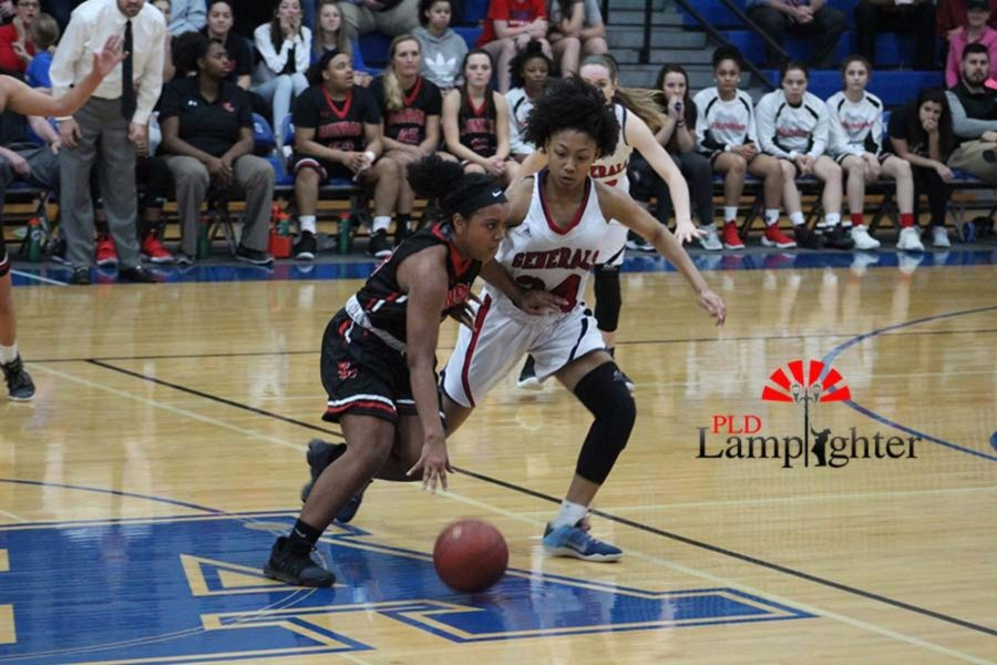 #23 Senior Mashayla Cecil fights to get past the defense.