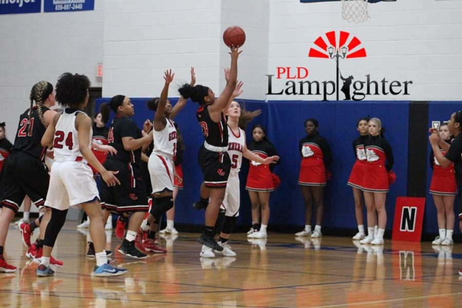 #23 Senior Mashayla Cecil shoots the layup over the defender.