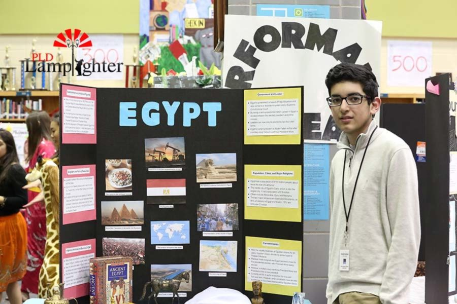Freshman Khalid Rashad poses with his board of Egypt.